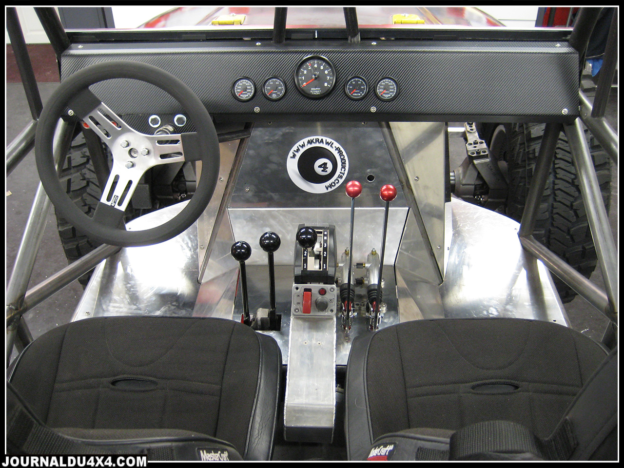 Levers from Left to Right : Atlas Shifters, Transmission Shifter, Front and Rear Left/Right Cutting Brakes